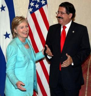 Hillary Clinton, with her boss.