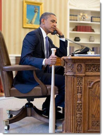 barack-obama-holding-bat-while-on-phone-turkey-prime-minister