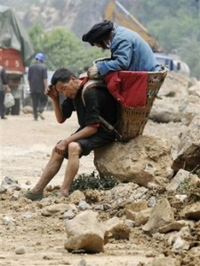 Chinese-man-carrying-his-mother-225x300